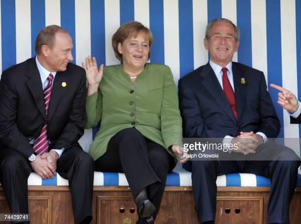 Russian President Vladimir Putin, German Chancellor Angela Merkel and U.S. President George W. Bush joke as they sit in a beach chair during the...