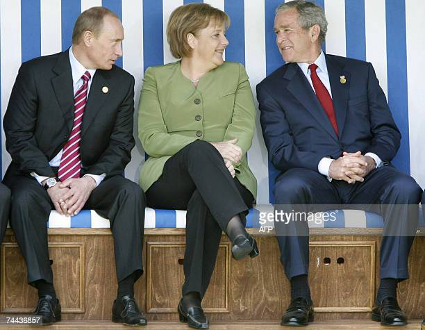 Russian President Vladimir Putin German Chancellor Angela Merkel US President George W Bush sit in a giant beach chair as G8 Heads of State pose for...