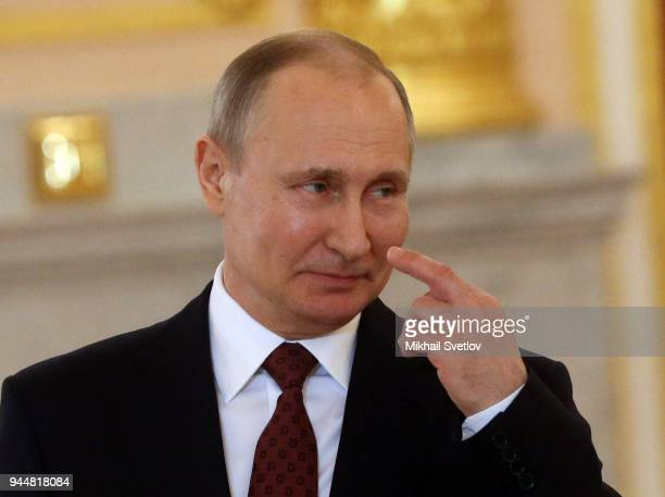 Russian President Vladimir Putin gestures during a reception for new foreign ambassadors at the Grand Kremlin Palace in Moscow Russia April 2018...