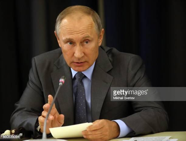 Russian President Vladimir Putin gestures during his meeting with German businessmen October 12 2017 in Sochi Russia Vladimir Putin receives CEO of...