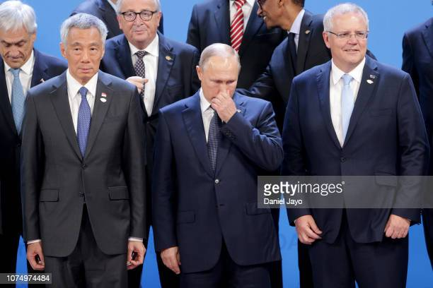 Russian President Vladimir Putin gestures during the family photo on the opening day of Argentina G20 Leaders' Summit 2018 at Costa Salguero on...