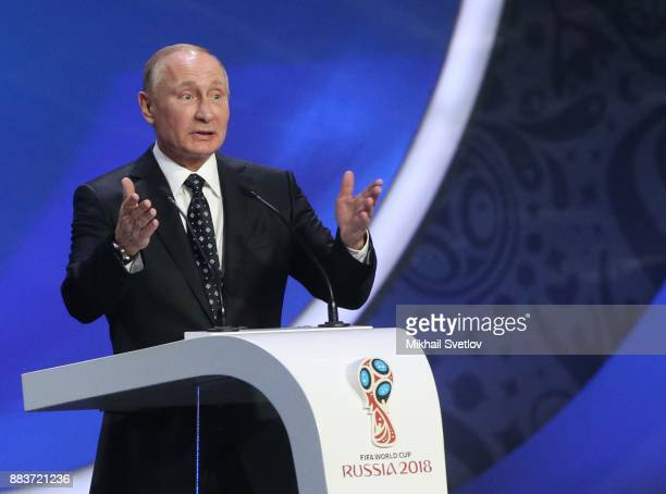 Russian President Vladimir Putin gestures during the Final Draw of 2018 FIFA World Cup at State Kremlin Palace in Moscow Russia December 1 2017