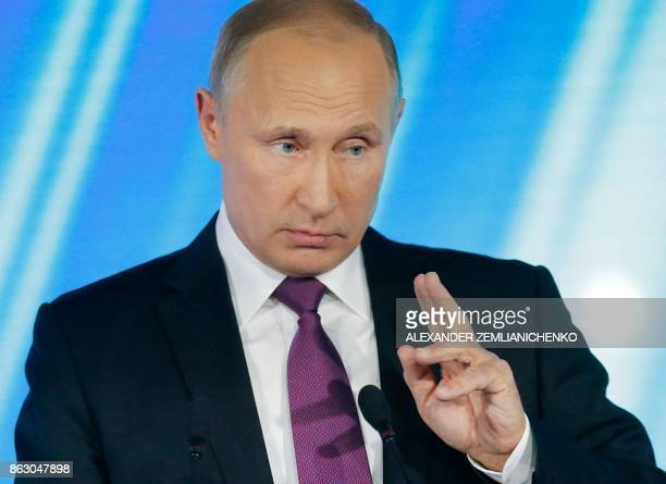 Russian President Vladimir Putin gestures while delivering a speech at the annual Valdai club conference of international experts in Sochi on October...