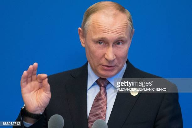 Russian President Vladimir Putin gestures while speaking to the media after the Belt and Road Forum at the China National Convention Center at the...