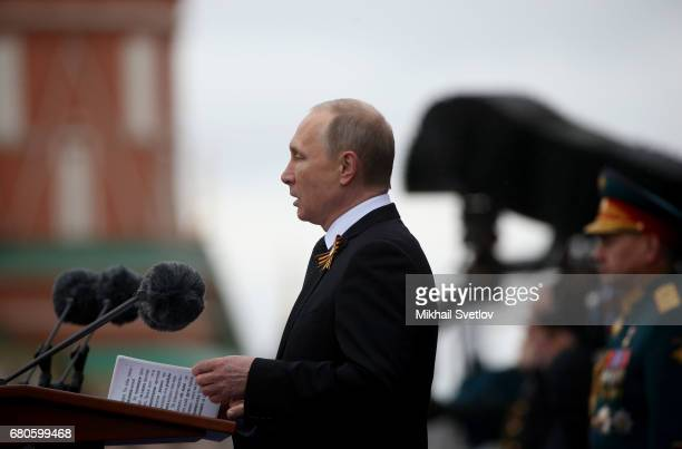 Russian President Vladimir Putin gives a speech as he attends the Victory Day military parade to celebrate the 72nd anniversary of the victory in...