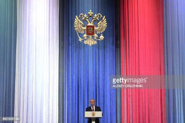 TOPSHOT Russian President Vladimir Putin gives a speech at a reception marking Russia's Heroes of the Fatherland Day at the Kremlin in Moscow on...