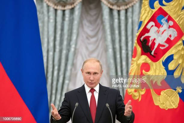 TOPSHOT Russian President Vladimir Putin gives a speech at an awards ceremony for the Russian national football team at the Kremlin in Moscow on July...
