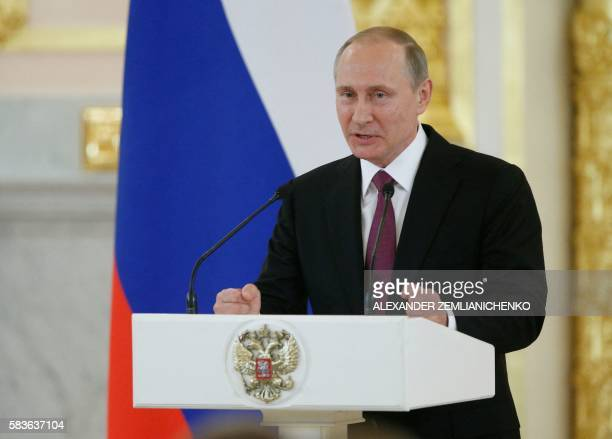 Russian President Vladimir Putin gives a speech during a meeting with members of the country's Olympic team at the Kremlin in Moscow on July 27,...