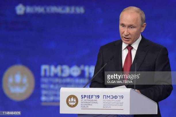 Russian President Vladimir Putin gives a speech during a plenary session of the St Petersburg International Economic Forum in Saint Petersburg on...