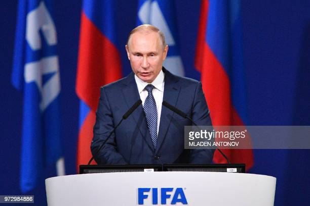 Russian President Vladimir Putin gives a speech during the 68th FIFA Congress at the Expocentre in Moscow on June 13 2018
