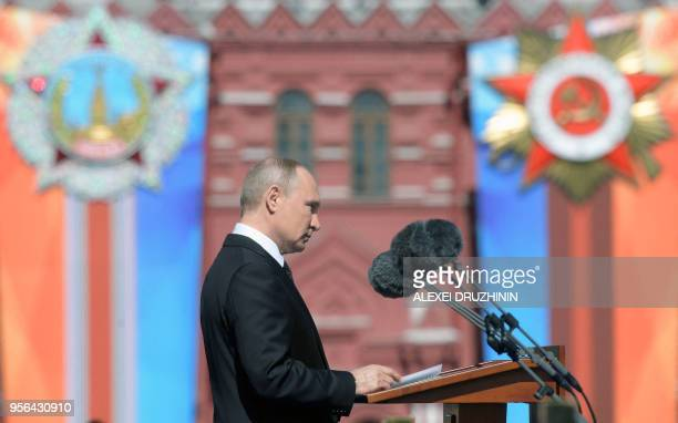 Russian President Vladimir Putin gives a speech during the Victory Day military parade at Red Square in Moscow on May 9 2018 Russia marks the 73rd...