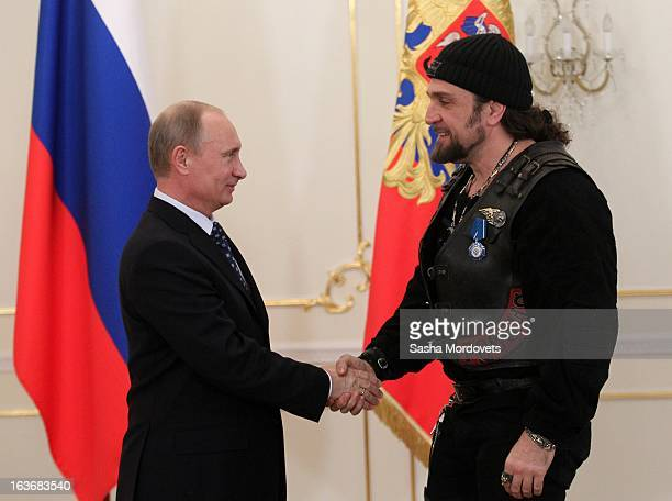 Russian President Vladimir Putin gives the Order of Honour to Night Wolves biker club leader Alexander Zaldostanov during a ceremony with the Russian...