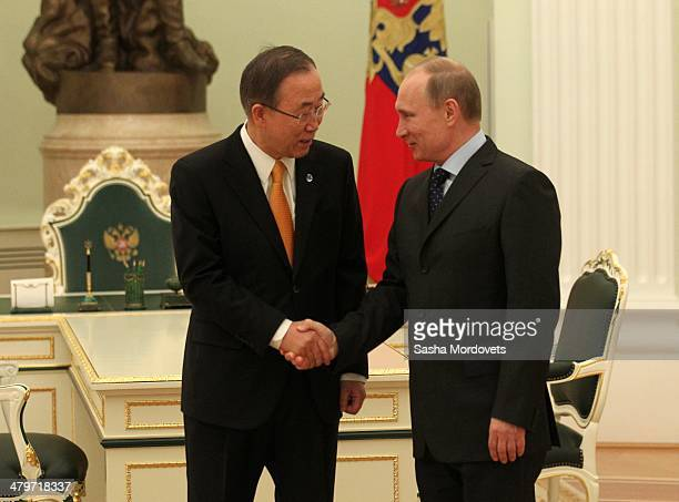 Russian President Vladimir Putin greeets UN SecretaryGeneral Ban Kimoon in the Kremlin on March 20 2014 in Moscow Russia Putin and Kimoon discussed...