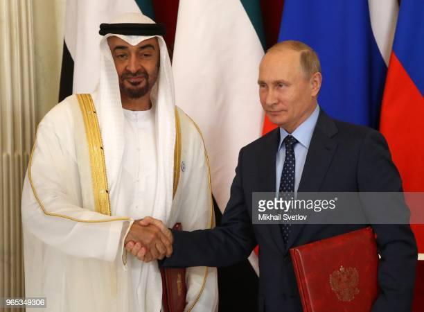 Russian President Vladimir Putin greets Abu Dhabi's Crown Prince and Deputy Supreme Commander of UAE's Armed Forces Sheikh Mohammed bin Zayed bin...