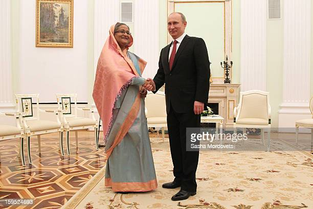 Russian President Vladimir Putin greets Bangladesh's Prime Minister Sheikh Hasina during their meeting at the Kremlin on January 15 2013 in Moscow...