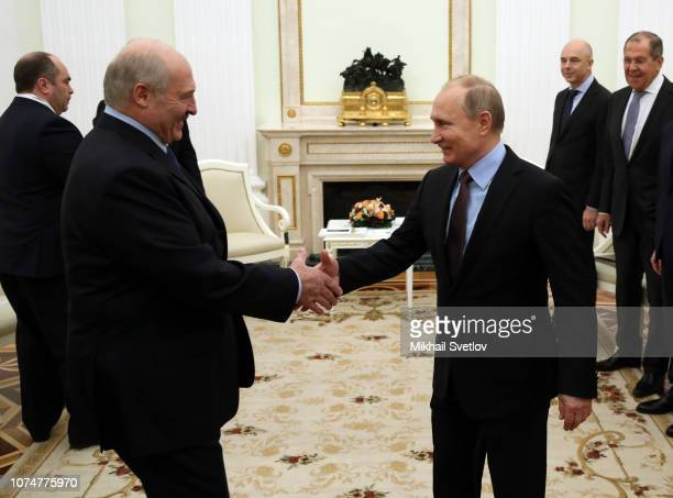 Russian President Vladimir Putin greets Belarussian President Alexander Lukashenko during their talks at the Kremlin on December 25 2018 in Moscow...