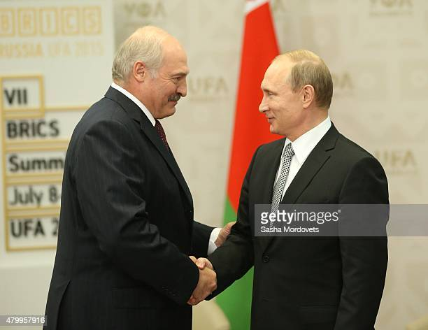 Russian President Vladimir Putin greets Belarussian President Alexander Lukashenko during their bilateral meeting at the BRICS 2015 Summit on July 8,...