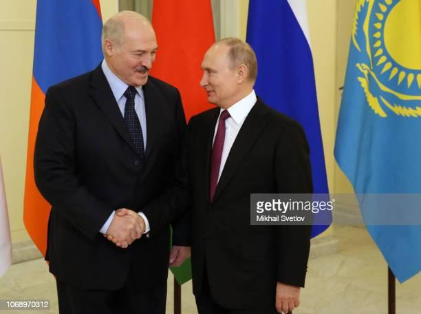 Russian President Vladimir Putin greets Belarussian President Alexander Lukashenko during the meeting on December 6 2018 in Saint Petersburg Russia...