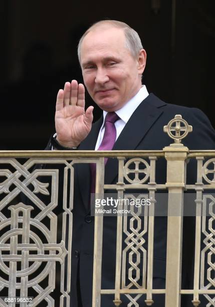 Russian President Vladimir Putin greets belivers while visiting the Sretensky Monastery on May 25 2017in Moscow Russia Newly built temple of the...