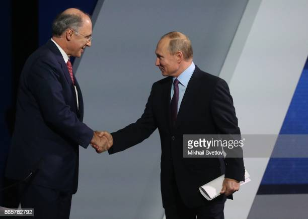 Russian President Vladimir Putin greets CEO of London Stock Exchange Group Xavier Rolet during the VTB Russia Calling Forum in Moscow Russia October...