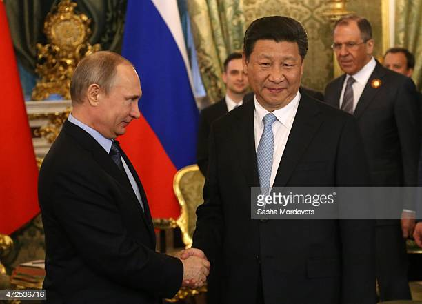 Russian President Vladimir Putin greets Chinese President Xi Jinping during their meeting in the Grand Kremlin Palace in Moscow Russia May2015 Xi...