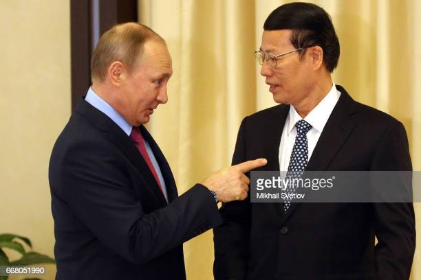 Russian President Vladimir Putin greets Chinese Vice Primier Zhang Gaoli during their meeting at the Novo-Ogaryovo State Residence on April 2017...