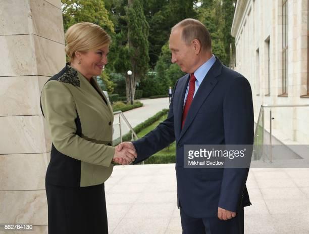 Russian President Vladimir Putin greets Croatian President Kolinda GrabarKitarovic during their meeting on October 18 2017 in Sochi Russia The...