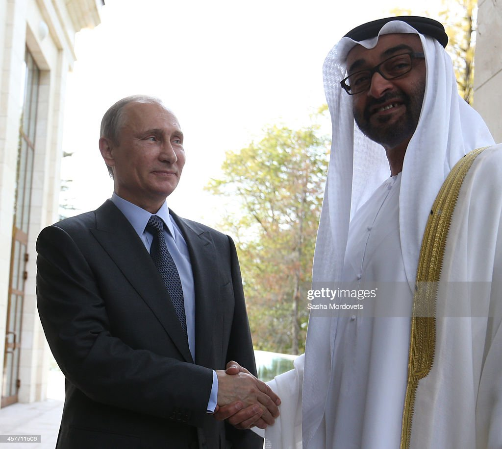 Russian President Vladimir Putin (L) greets Crown Prince of Abu Dhabi Sheikh Abdullah bin Zayed al-Nahayn (R) during their meeting on October 23, 2014 in Sochi, Russia. Crown Prince of Abu Dhabi is having a one-day visit to Russia.