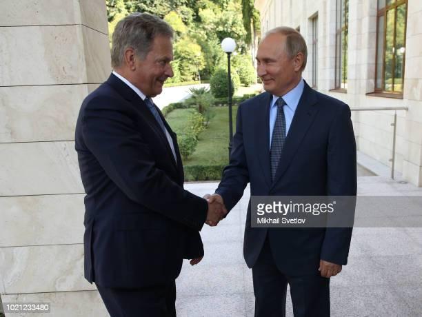 Russian President Vladimir Putin greets Finnish President Sauli Niinisto during their meeting at Bocharov ruchey state residence on August 22 2018 in...