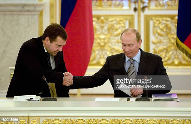 Russian President Vladimir Putin greets First Deputy Premier and presidential hopeful Dmitry Medvedev at a Kremlin meeting in Moscow on February 28...