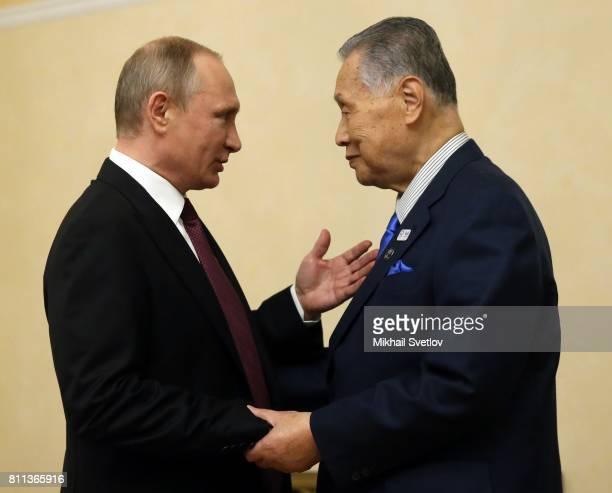 Russian President Vladimir Putin greets former Japanese Prime Minister Yoshiro Mori during their meeting in Yekaterinburg Russia July2017 Vladimir...