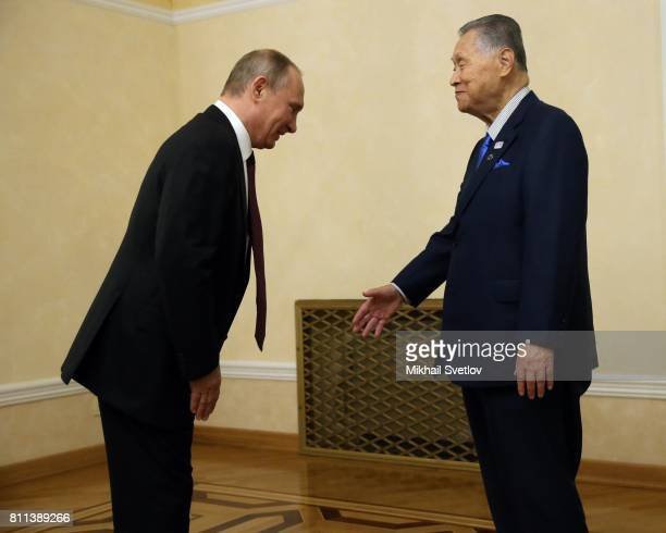 Russian President Vladimir Putin greets former Japanese Prime Minister Yoshiro Mori during their meeting on July 9 2017 in Yekaterinburg Russia...
