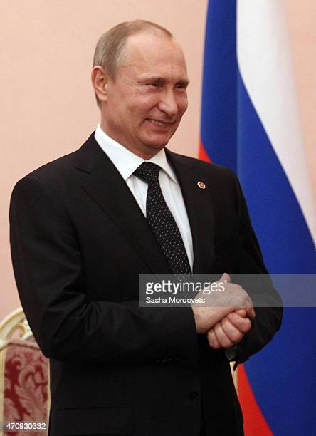 Russian President Vladimir Putin greets French President Francois Hollande during their meeting in Yerevan Armenia April2015 Putin and Hollande are...
