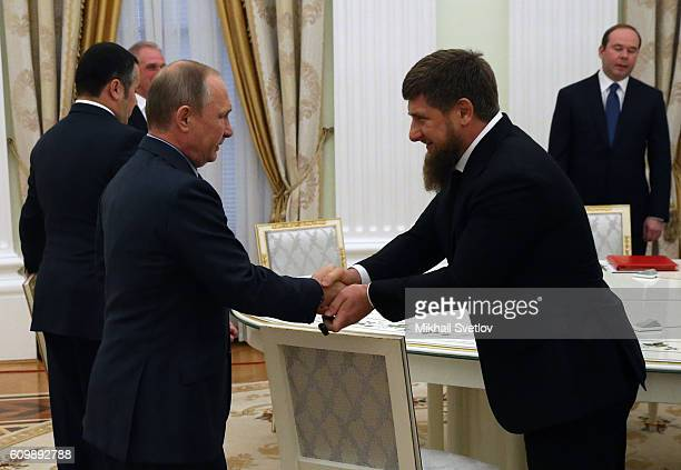 Russian President Vladimir Putin greets Head of Chechnya Ramzan Kadyrov during his meeting with newly elected governors at the Kremlin on September...