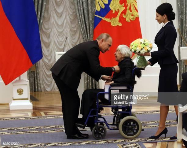 Russian President Vladimir Putin greets Human Rights leading activist Helsinki Watch Group member Lyudmila Alexeyeva during an awarding cemeremony at...