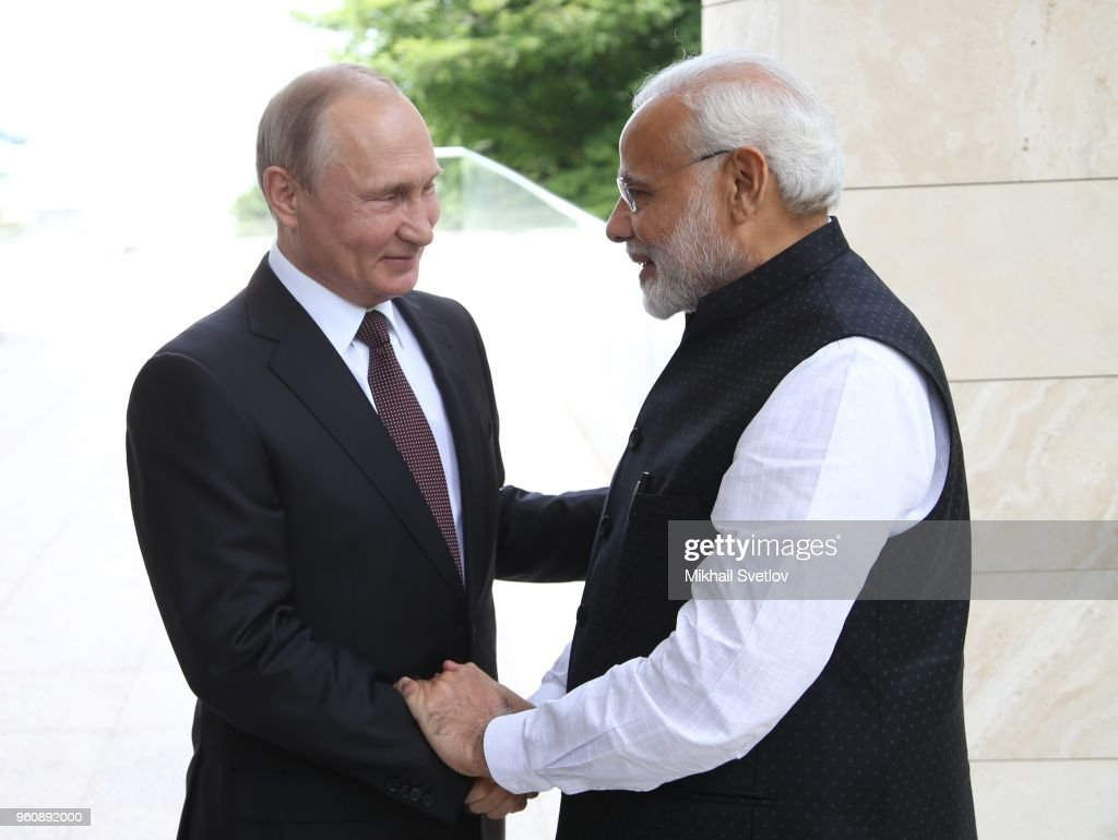Russian President Vladimir Putin (L) greets Indian Prime Minister Narendra Modi (R) during their meeting at Bocharov ruchey State Residence on May 21, 2018 in Sochi, Russia. Modi is having a one-day visit to Russia.
