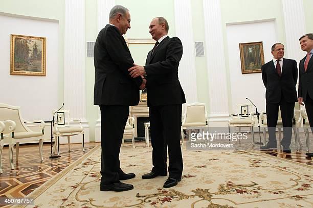 Russian President Vladimir Putin greets Israeli Prime Minister Benjamin Netanyahu as Russian Foreign Minister Sergey Lavrov and Presdential Advisor...