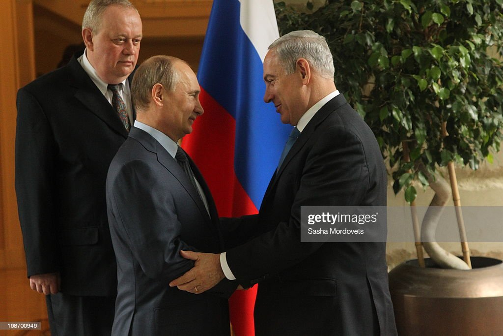Russian President Vladimir Putin (L) greets Israel's Prime Minister Benjamin Netanyahu at Bocharov Ruchei state residence on May 14, 2013 in Sochi, Russia. According to reports, Israel's concerns over Russian plans to sell Syrian President Bashar al-Assad an advanced air defense system will be raised.