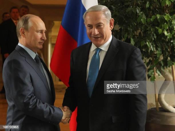 Russian President Vladimir Putin greets Israel's Prime Minister Benjamin Netanyahu at Bocharov Ruchei state residence on May 14 2013 in Sochi Russia...