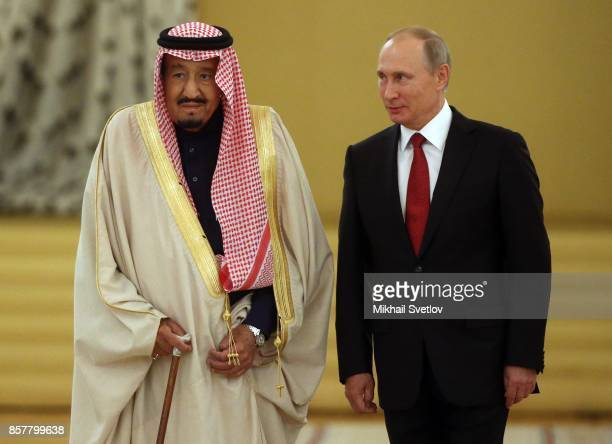Russian President Vladimir Putin greets King Salman bin Abdulaziz Al Saud of Saudi Arabia at the Grand Kremlin Palaceon October 5, 2017 in Moscow,...