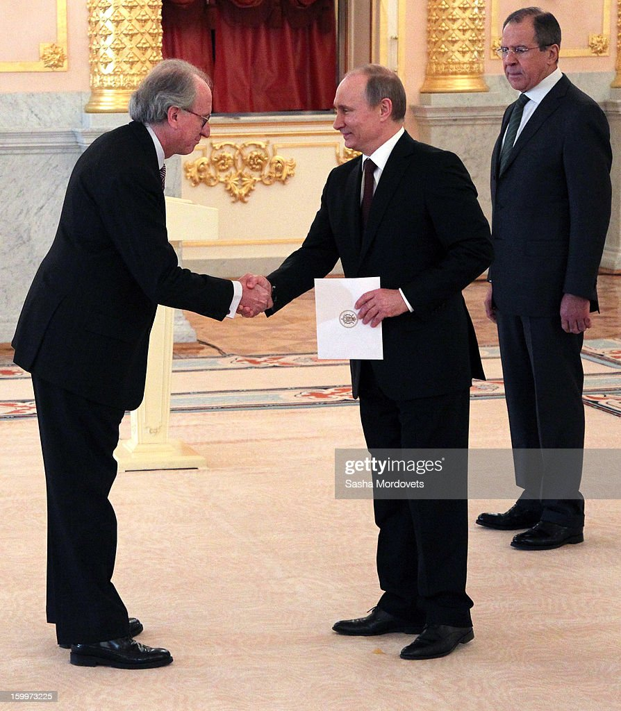 Russian President Vladimir Putin (C) greets new ambassador of Spain Jose Ignacio Carbajal Garate (L) during a reception for new ambassadors in the Alexander Hall of the Grand Kremlin Palace January 24, 2013 in Moscow, Russia. Putin received 20 new foreign ambassadors.
