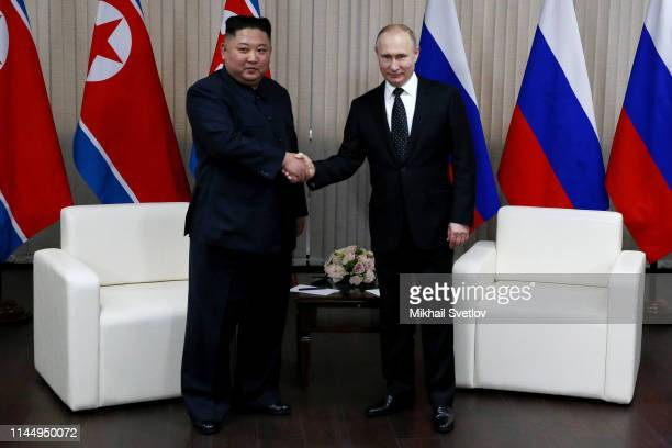 Russian President Vladimir Putin greets North Korean Leader Kim Jong-un during their meeting on April 25, 2019 in Vladivostok, Russia. Russian...