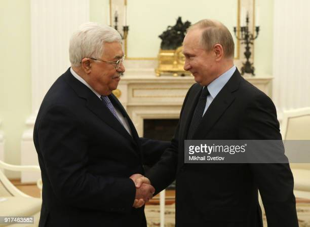 Russian President Vladimir Putin greets Palestinan President Mahmoud Abbas at the Kremlin on February 12 2018 in Moscow Russia