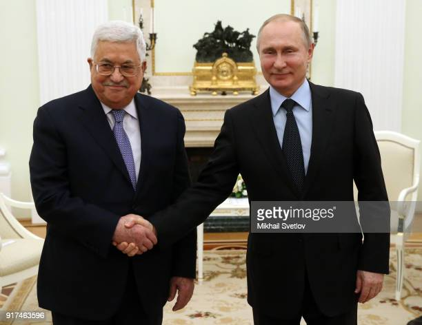 Russian President Vladimir Putin greets Palestinan President Mahmoud Abbas during their meeting at the Kremlin on February 12 2018 in Moscow Russia