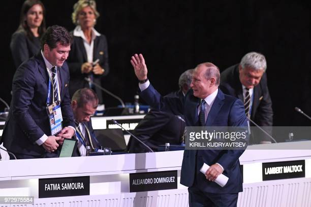 Russian President Vladimir Putin greets participants during the 68th FIFA Congress at the Expocentre in Moscow on June 13 2018