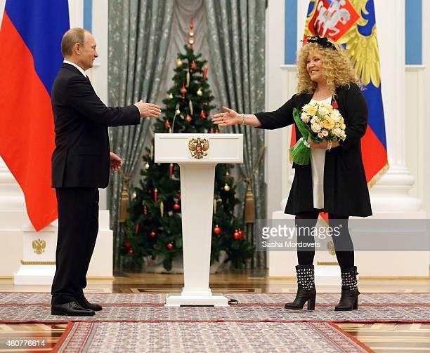 Russian President Vladimir Putin greets pop singer Alla Pugacheva during an awards ceremony in the Kremlin on December 22 2014 in Moscow Russia
