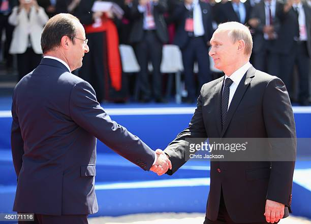 Russian President Vladimir Putin greets President Francois Hollande of France at a Ceremony to Commemorate D-Day 70 on Sword Beach on June 6, 2014 in...