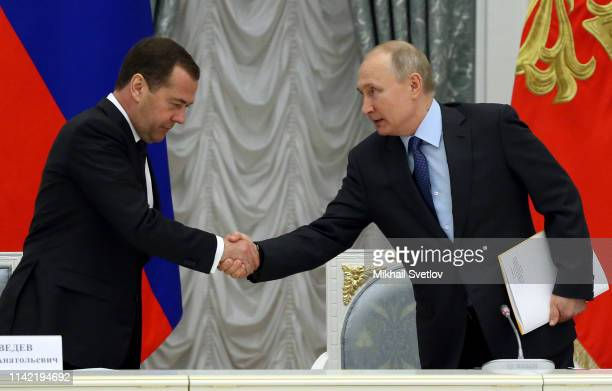 Russian President Vladimir Putin greets Prime Minister Dmitry Medvedev during the Council on National Projects at the Kremlin on May 8 2019 in Moscow...