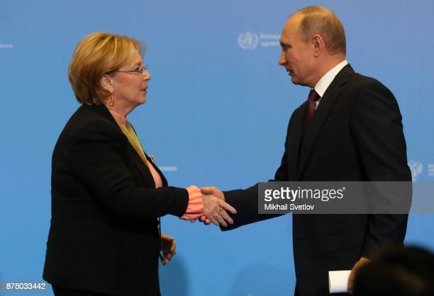 Russian President Vladimir Putin greets Russian Health Minister Veronika Skvortsova during fhe first WHO global ministerial conference ending TB in...