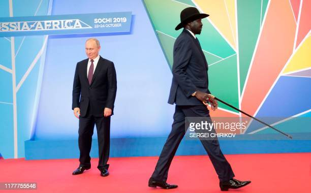TOPSHOT Russian President Vladimir Putin greets South Sudan's President Salva Kiir Mayardit during the official welcoming ceremony for the heads of...